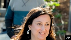This photo taken on April 4, 2016 shows Daphne Galizia, the Maltese investigative journalist who exposed her island nation's links with the so-called Panama Papers. Galizia was killed on Monday, Oct. 16, 2017, when a bomb destroyed her car as she was driving near her home.