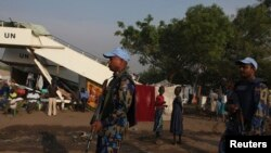FILE - U.N. police officers patrol a United Nations camp for internally displaced persons in Juba.