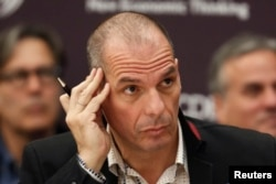 File - Greek Finance Minister Yanis Varoufakis attends a conference at OECD headquarters in Paris, April 9, 2015.