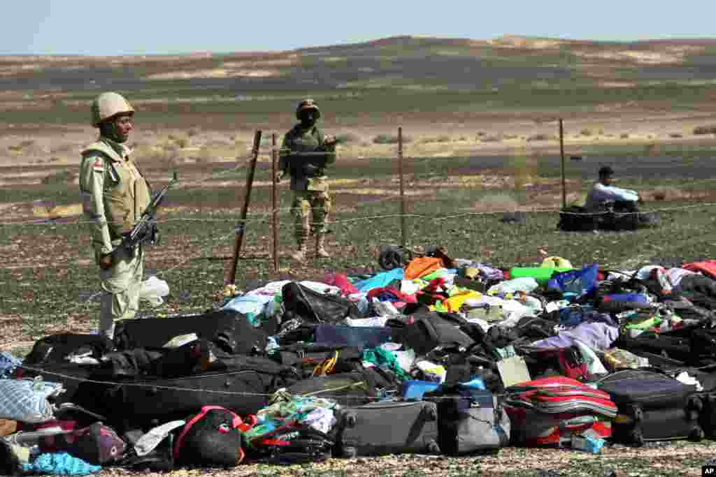 Egyptian Army soldiers stand near luggage and personal belongings of passengers a day after a passenger jet bound for St. Petersburg, Russia, crashed in Hassana, Egypt. The Metrojet plane crashed 23 minutes after it took off from Egypt's Red Sea resort of Sharm el-Sheikh on Oct. 31, 2015. All 224 people on board died.