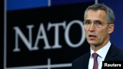 NATO Secretary General Jens Stoltenberg speaks at the alliance's headquarters during a NATO foreign ministers meeting in Brussels December 2, 2014.