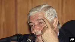 Syrian Foreign Minister Walid al-Moualem speaks during a news conference in Damascus, June 22, 2011