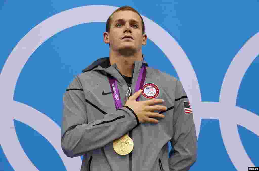Tyler Clary of the U.S. sings his national anthem with his gold medal on the podium after winning the men's 200m backstroke final during the London 2012 Olympic Games at the Aquatics Centre August 2, 2012.