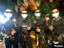 FILE - Four Thai navy SEALs are seen after leaving the cave safe during the rescue mission, Chiang Rai Province, Thailand, July 10, 2018 in this photo obtained from social media.