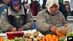 FILE - Vendors sell vegetables at a city market in Bishkek city market in Bishkek, Kyrgyzstan.