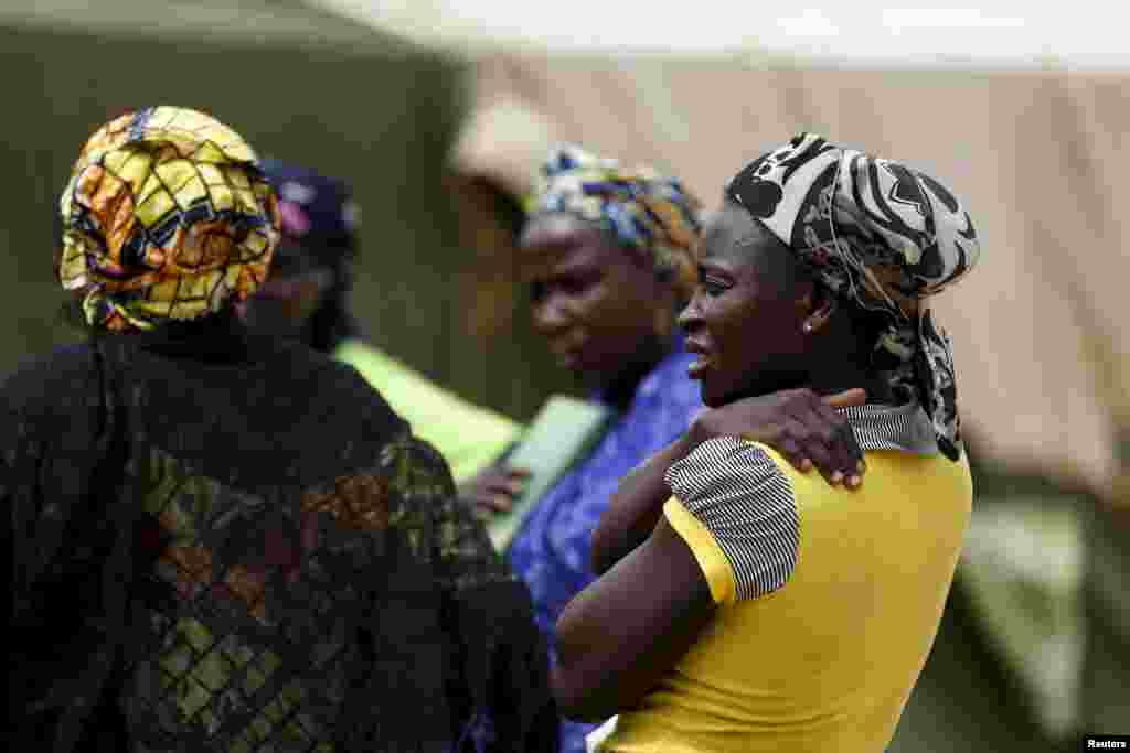 Women gather at the camp as more women and children rescued from Sambisa arrive, May 3, 2015.
