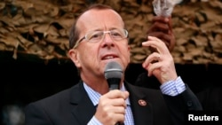 FILE - Martin Kobler, U.N. special envoy to the Democratic Republic of the Congo, addresses troops outside Goma, Aug. 31, 2013.