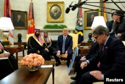 U.S. President Donald Trump, flanked by Energy Secretary Rick Perry, delivers remarks as he welcomes Saudi Arabia's Crown Prince Mohammed bin Salman in the Oval Office at the White House in Washington, March 20, 2018.