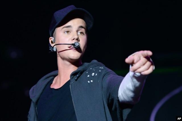 Recording artist Justin Bieber performs at the 2015 Billboard Hot 100 Music Festival at Nikon at Jones Beach Theater in Wantagh, NY.