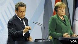 Presiden Perancis Nicolas Sarkozy dan Kanselir Jerman Angela Merkel belum mencapai kesepakatan bersama soal solusi utang Yunani.
