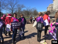 Women prepare to march in International Women's Day Protest in Washington, D.C. on March 8, 2017. (Photo: E. Sarai / VOA)