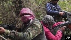 Beberapa anggota dari Free Syrian Army, atau tentara pembebasan Suriah, pasukan pemberontak yang menentang Presiden Bashar al-Assad.
