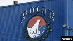 FILE - The corporate logo of Empresas Polar is seen at a facility of the company in Caracas July 30, 2015.
