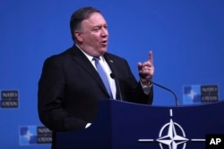 FILE - U.S. Secretary of State Mike Pompeo speaks during a media conference after a meeting of NATO foreign ministers at NATO headquarters in Brussels, Tuesday, Dec. 4, 2018.