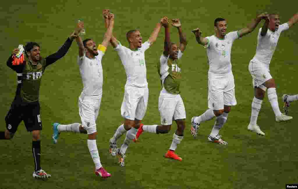 From left: Algeria's Mohamed Lamine Zemmamouche, Rafik Halliche, Nabil Bentaleb, Yacine Brahimi, Essaid Belkalem and Sofiane Feghouli celebrate their win over South Korea at the Beira Rio stadium in Porto Alegre, June 22, 2014.