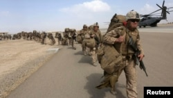 U.S. Marines prepare to depart at the end of operations for Marines and British combat troops in Helmand, Afghanistan, Oct. 27, 2014.