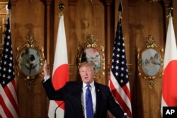 President Donald Trump speaks, accompanied by Japanese Prime Minister Shinzo Abe during a joint news conference at the Akasaka Palace, Monday, Nov. 6, 2017, in Tokyo.