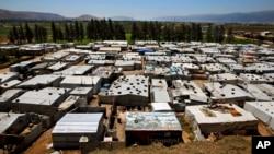 Lübnan'ın Bekaa Vadisi'nde, Bar İlyas yakınlarında çadırlardan oluşan Suriyeli mülteci kampı