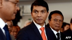 FILE - Madagascar's transitional leader Andry Rajoelina (C) attends a ceremony at Antananarivo's Town Hall, on May 13, 2013.
