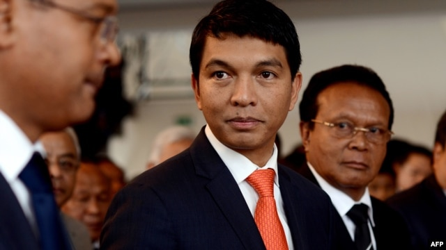 Madagascar's transitional leader Andry Rajoelina (C) attends a ceremony at Antananarivo's Town Hall to commemorate the students' unrest in 1972 which led to the first Republic's fall, May 13, 2013.