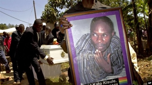 A member of the Ugandan gay community carries a picture of murdered gay activist David Kato during his funeral near Mataba, January 28, 2011.