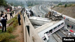 Rescue workers pull victims from a train crash near Santiago de Compostela, northwestern Spain, July 24, 2013.