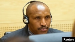 FILE - Congolese militia leader Bosco Ntaganda appears at the International Criminal Court charged with war crimes and crimes against humanity in a hearing in The Hague, Feb. 10, 2014.