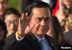 FILE - Thailand's Prime Minister Prayuth Chan-ocha waves as he arrives for a group photo of leaders at the 11th Asia-Europe Meeting (ASEM) in Ulaanbaatar, Mongolia.