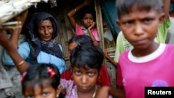 FILE - Rohingya Muslims are seen in Bawdupa IDP camp outside of Sittwe.