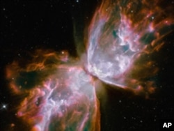 "These roiling cauldrons of gas are actually a dying star that was once about five times the mass of the sun. The ""butterfly"" stretches for more than two million light-years."