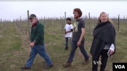 Virginia winery owner Doug Fabbioli walks with farming students at his free agriculture school.