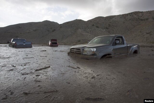 FILE - A mudslide Thursday left nearly 200 vehicles, including 75 semitrailer trucks, stuck in up to five feet of mud and debris on State Route 58 near Tehachapi, California, local police said, Oct. 17, 2015.