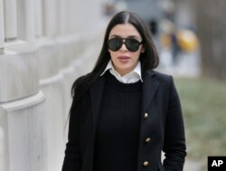 "FILE - Emma Coronel Aispuro, wife of Joaquin ""El Chapo"" Guzman, arrives at federal court in New York, Dec. 6, 2018, for her husband's trial."