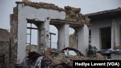 지난 14일 시리아 알레포에서 공습으로 파괴된 건물. (자료사진)