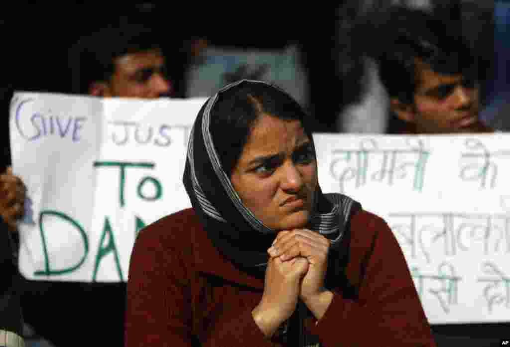 An India woman participates in a protest against the recent gang rape of a young woman in moving bus, in New Delhi, India, January 7, 2013.