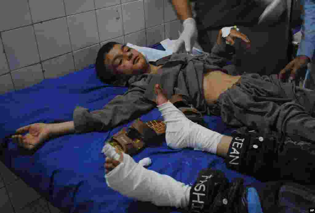 Boys injured in a suicide bombing are treated at a hospital in Peshawar, Pakistan, June 21, 2013.