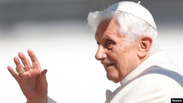 Pope Benedict XVI waves to the faithful as he arrives in St Peter's Square to hold his last general audience at the Vatican, February 27, 2013.