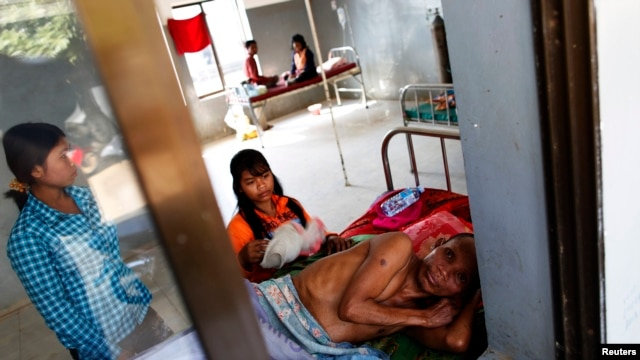 FILE - A malaria patient is comforted in the only hospital in Pailin, western Cambodia.