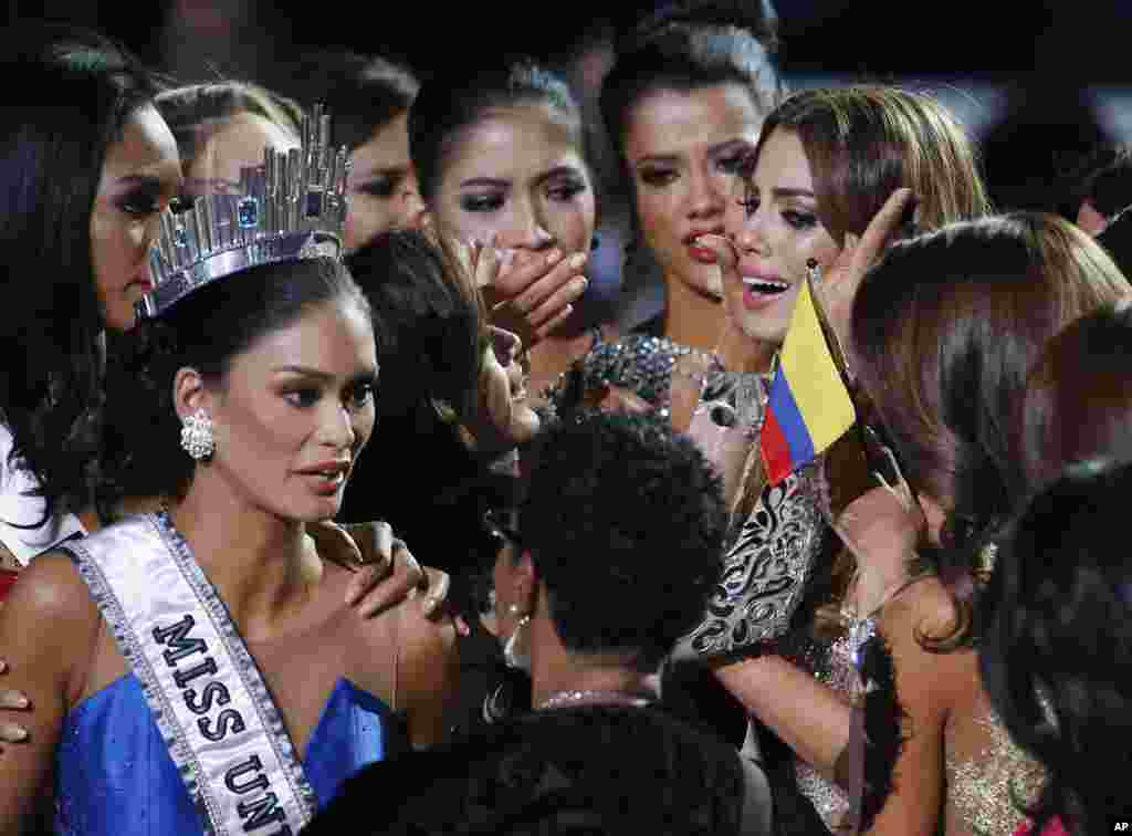 Contestants comfort Miss Colombia, Ariadna Gutierrez, top right, after she was incorrectly crowned Miss Universe at the Miss Universe pageant in Las Vegas, Dec. 20, 2015. Host Steve Harvey made a mistake when announcing the first runner-up, Miss Colombia, as the winner before they took it away and gave it to Miss Philippines Pia Alonzo Wurtzbach, pictured on the left.