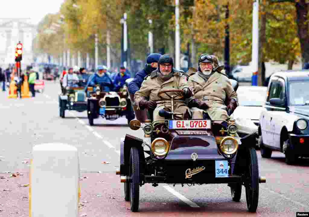 Participants in the London to Brighton Veteran Car Run make their way down The Mall, in London, Britain.