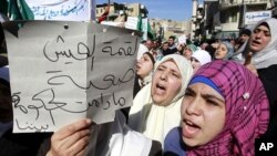 Protesters from opposition parties and labor unions shout anti-government slogans in Amman, January 28, 2011