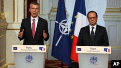 NATO Secretary-General Jens Stoltenberg of Norway, left, speaks during a joint news conference with French President Francois Hollande, after their meeting at the Elysee Palace in Paris, March 2, 2015.