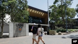 In this Dec 1, 2020, file photo, students walk around the University of New South Wales campus in Sydney, Australia. (AP Photo/Mark Baker, File)