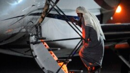 In this photo released by Ministry of Defense, Radical Muslim preacher Abu Qatada boards a private flight bound for Jordan, at RAF Northolt in London, July 7, 2013.