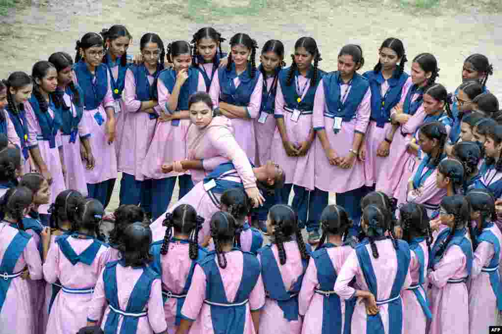 Indian Muslim international karate champion, Syeda Falak (C-L), shows self-defense methods to students at the Telangana Minorities Residential Girls School in Hyderabad.