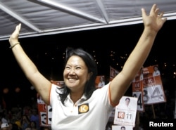 Peruvian presidential candidate Keiko Fujimori of the Fuerza Popular (Popular Force) party greets the media during a campaign rally in Villa Maria del Triunfo, on the outskirts of Lima, Feb. 29, 2016.