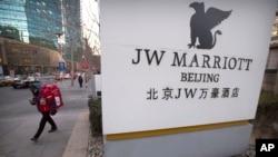 A deliveryman walks near entrance of a JW Marriott hotel in Beijing, China, Jan. 11, 2018.