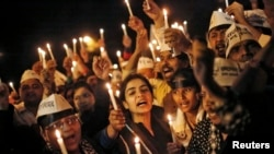 FILE - Candle light vigil to protest the rape of a female Uber passenger, in New Delhi, Dec. 8, 2014.