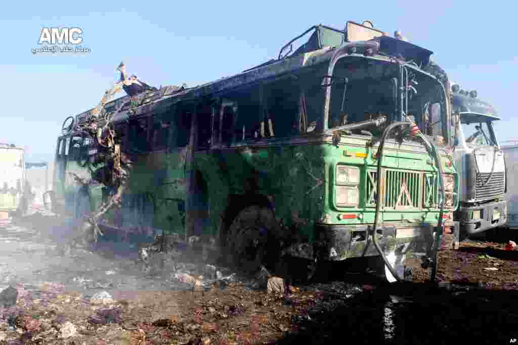 This citizen journalism image shows damages of a burned bus after a Syrian aircraft pummeled an opposition neighborhood in Aleppo, Syria, Dec. 22, 2013.