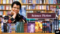 FILE - In this Feb. 4, 2004 file photo, author Octavia Butler poses near some of her novels at University Book Store in Seattle, Wash. (Joshua Trujillo/seattlepi.com via AP, File)